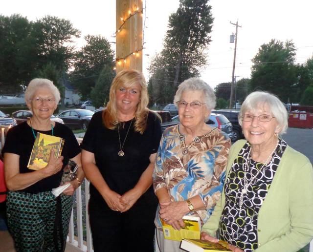 AAUW member, Ann Sanderson and guests pose with Ellen Marie Wiseman, author of The Plum Tree.