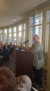 Lynn Schwabenthal, long time AAUW member and former president, introduces Sheriff O'Neill.